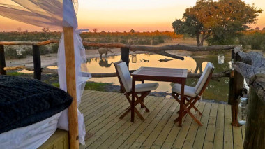 Sleep out elephants eye watering hole view Hwange Zimbabwe-Safari
