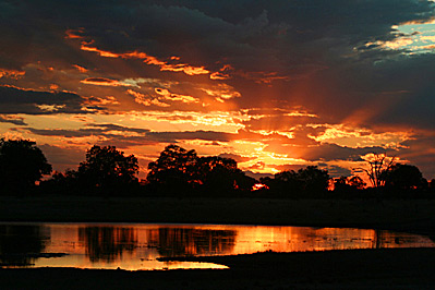 Sunset over a waterhole on a South Africa Safari