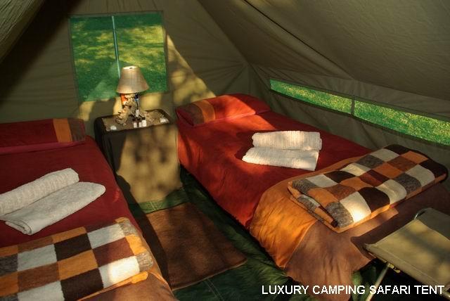 okavango delta river tents Botswana safari