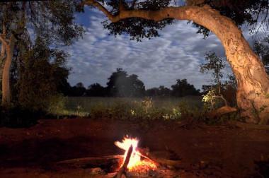 Okavango Delta river safari fire