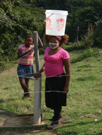 village lady carrying water wild coast eastern cape